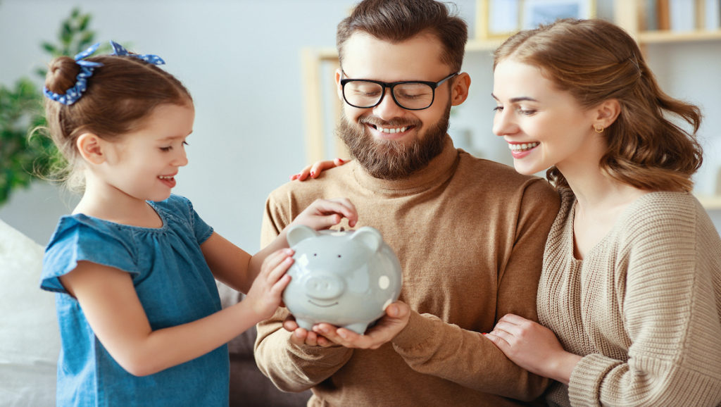 Family with piggy bank saving money